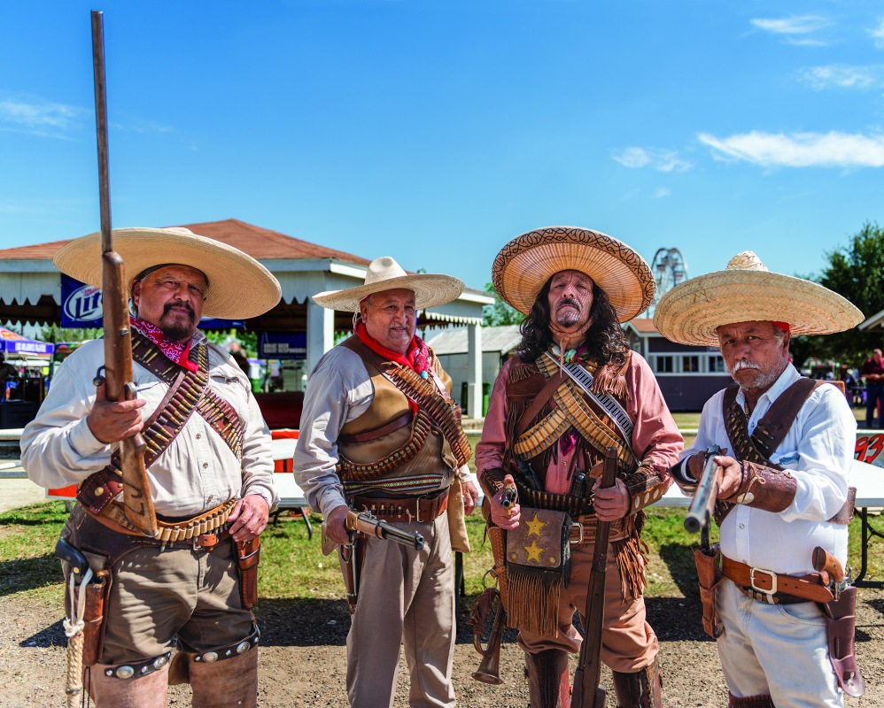 Lucio Jimenez, Pablo Martinez, Carlos Lara and Javier Rodriguez of the Los Liberadores Group have the desired menacing effect at the Zapata County Fair in South Texas.  (Photo: Carol M. Highsmith)